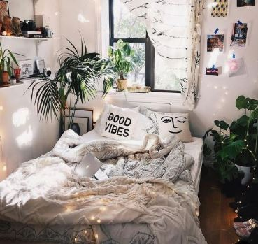 A bohemian bedroom with indoor plants, floating shelves, and a diamond ruffle duvet cover.