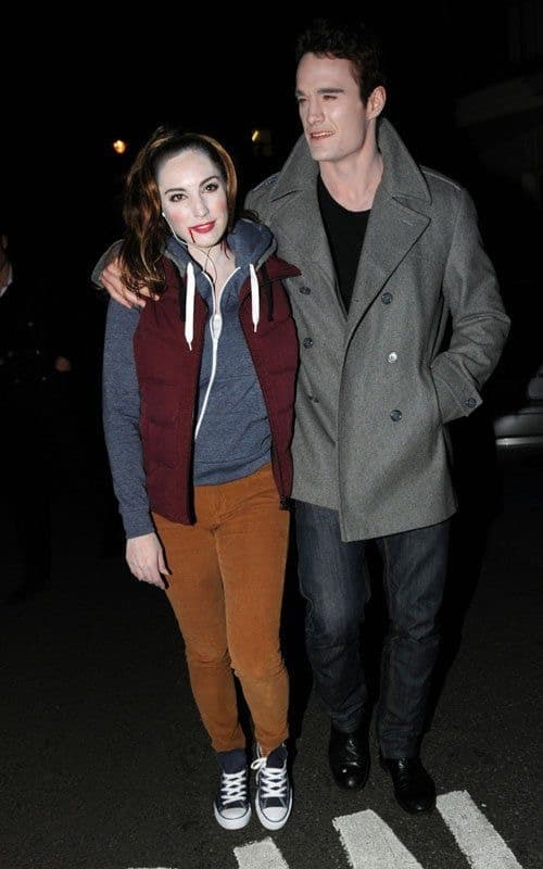 A woman and a man wearing matching Bella Swan and Edward Cullen costumes from the movie Twilight.