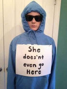 A woman wearing a blue hoodie with a caption and matching sunglasses inspired by Damien's character from Mean Girls.