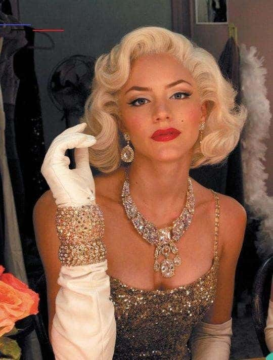 A woman wearing an iconic Marilyn Monroe evening gown with matching accessories.