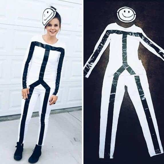 A woman wearing a black and white stick figure Halloween costume.