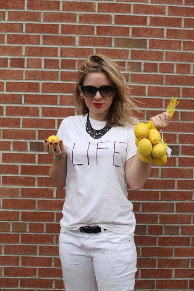"A woman wearing a gag costume inspired by the saying, ""When life hands you lemons, make lemonade."""