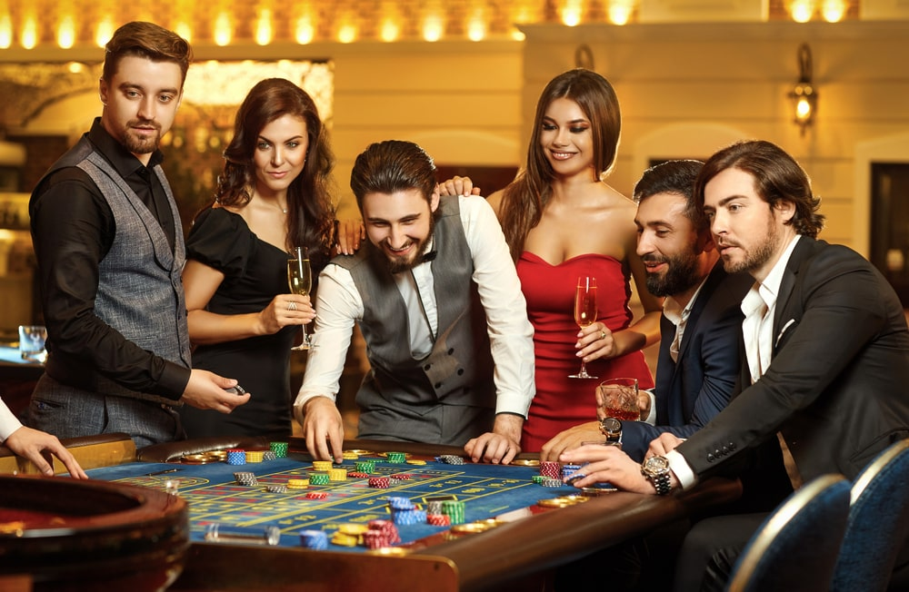 A group of friends gambling at a casino.