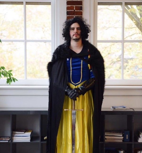 A man dressed in a Halloween costume that is a combination of Jon Snow and Snow White.