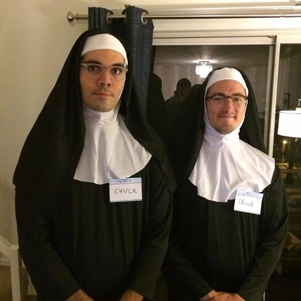 Two men dressed as nuns with Chuck nametags.