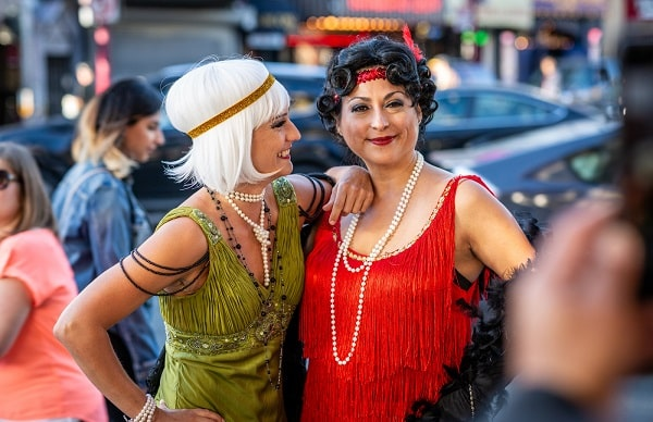 Two women in 1920s flapper girl costumes.
