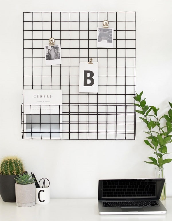 A minimalist dorm room with a grid panel and desktop essentials.