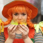 A woman dressed as Pippi Longstocking.
