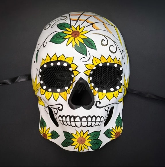 A Day of the Dead hand-painted mask with a sunflower design.