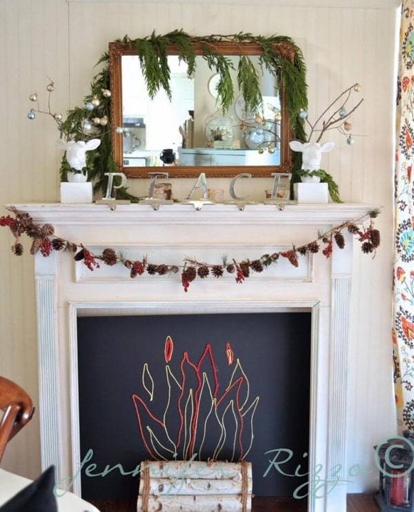 A fall-inspired faux fireplace made of chalkboard and colored strings.