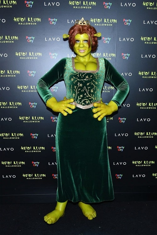 Heidi Klum dressed as Fiona from Shrek, wearing her green maiden dress and brown braided wig.