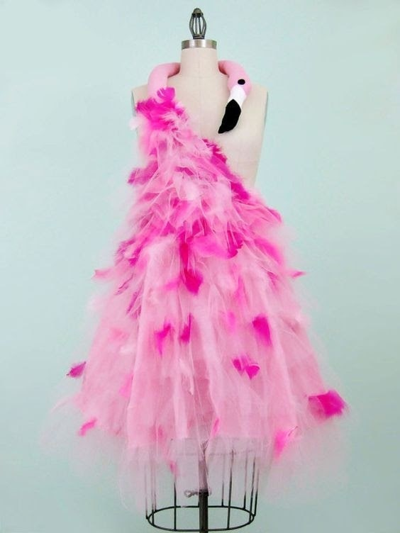 A flamingo dress made of coordinating pink tulle, feathers, and plushie.