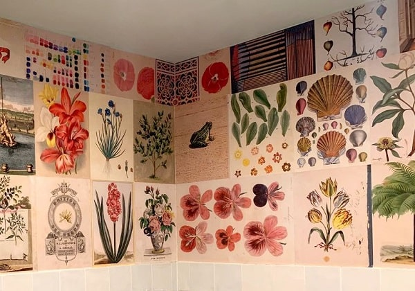 A dorm room with a DIY vintage wallpaper design made of various book cover pages.