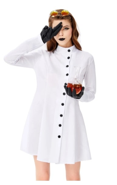 A woman in a mad scientist costume, wearing a lab coat-style dress with black gloves, glassware, and black lipstick.