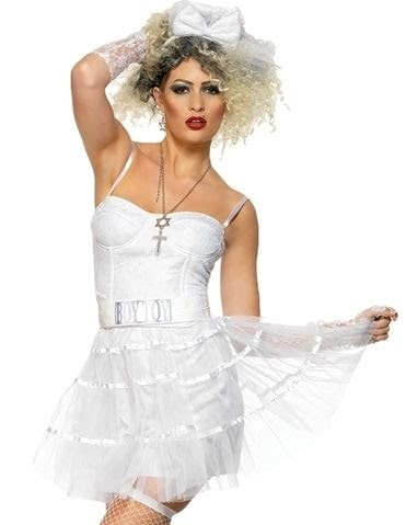 A woman in a Madonna costume, wearing a white lace dress with matching pop diva accessories.