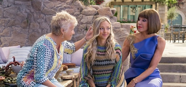 Amanda Seyfried as Sophie in Mamma Mia! Here We Go Again, wearing her knitted poncho.