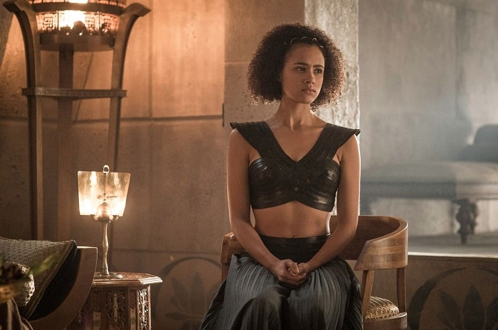 Missandei from the TV series Game of Thrones, wearing her black top and skirt and gold headpiece.