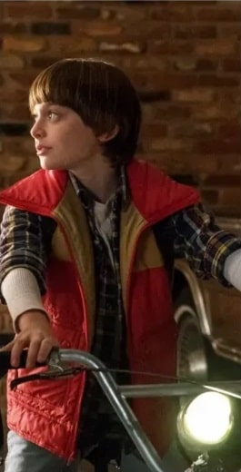 Will Byers wearing his plaid shirt and red vest in Stranger Things Season 3.