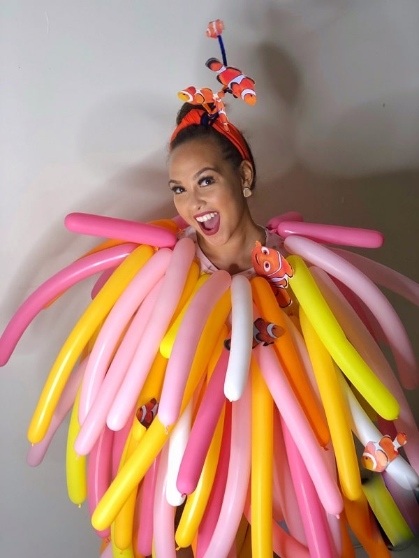 A woman dressed as a sea anemone, with her costume made of balloons and cut-out pictures of Nemo and other clown fish.