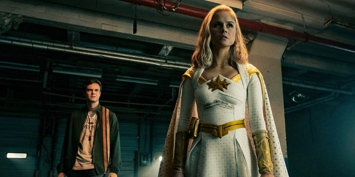 Starlight in a scene from The Boys, with her white and gold superhero costume.