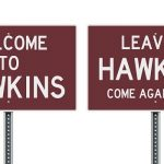 Side-by-side Hawkins entrance and exit signages.