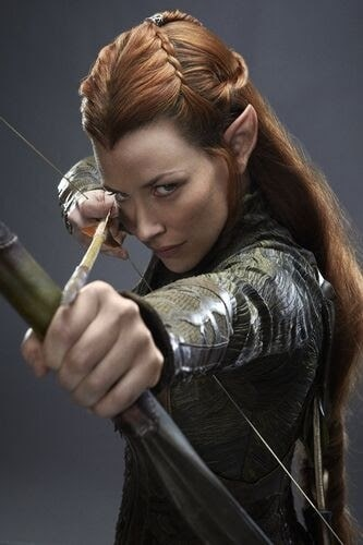 Evangeline Lilly as Tauriel with her elf ears and reflex bow and arrow.