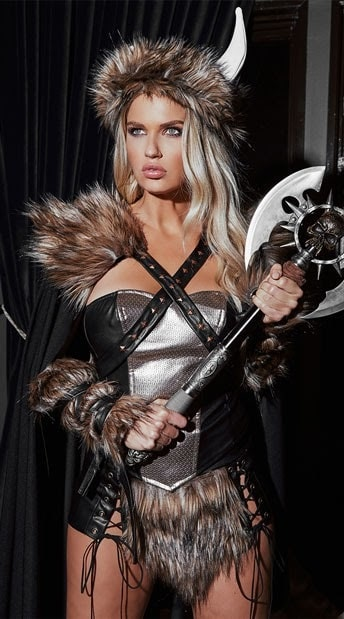 A woman in a Viking warrior costume, complete with faux fur trim, armor, and horned helmet.