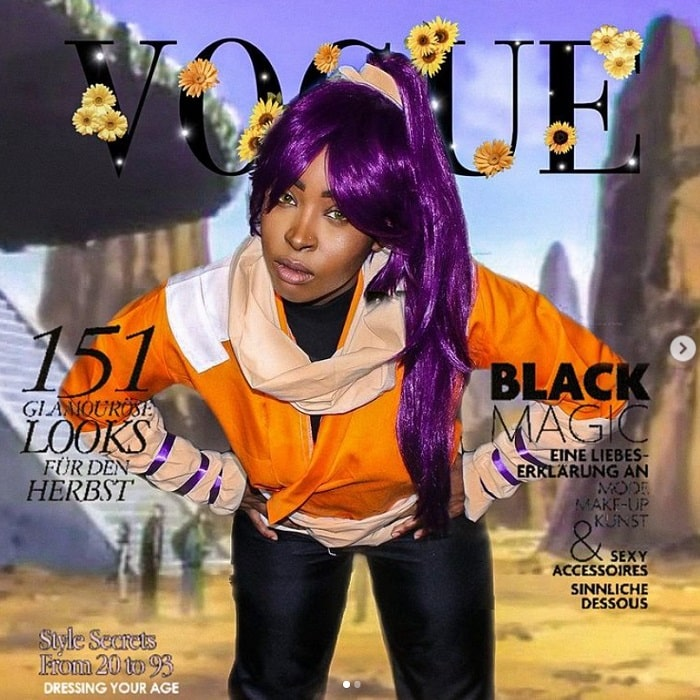 A woman dressed as Yoruichi Shihouin from Bleach, in her orange top, black pants, and purple hair.