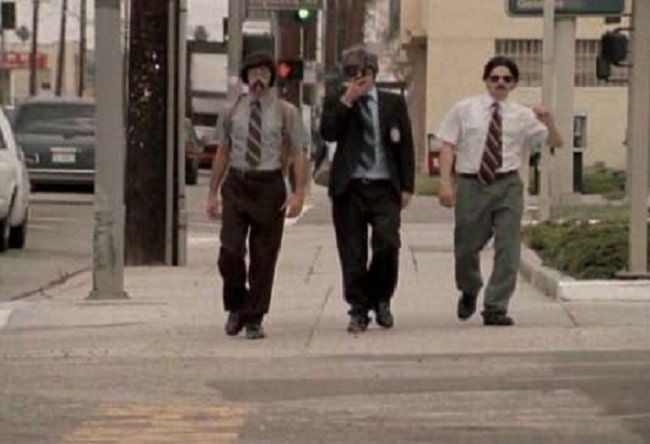 The Beastie Boys in their Sabotage music video, wearing their mustaches, neckties, and suspenders.