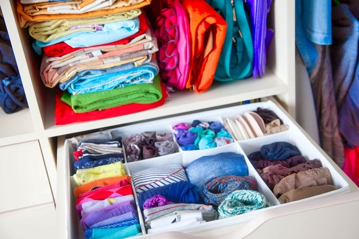A well-organized drawer with dividers to separate various types of small clothing.