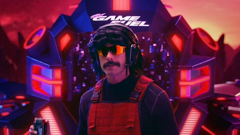 Dr. DisRespect with his mustache, wearing his polarized sunglasses, red tactical vest, and gamer's headset.