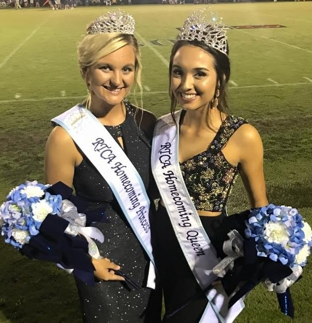 Robert Toombs Christian Academy homecoming princess and queen, wearing their sashes, wrist corsages, and bejeweled tiaras.