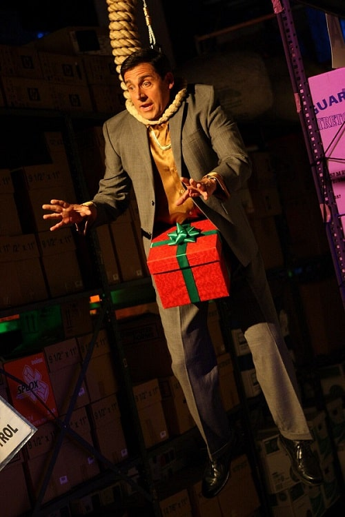 Michael Scott as a dick-in-a-box, with a red gift-wrapped box tied with a green ribbon and bow attached to his crotch.