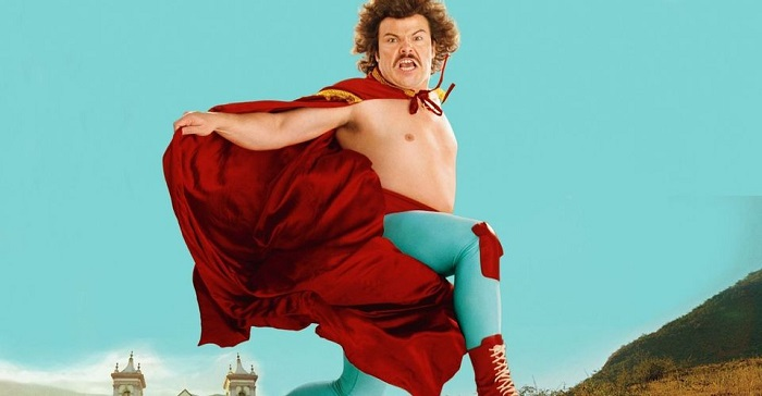Jack Black as Nacho Libre, with his mustache and wearing his Mexican wrestling costume with matching red cape.