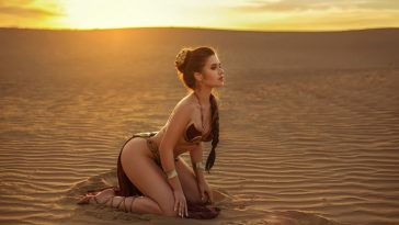 A woman in an iconic Princess Leia costume inspired by the 1983 Star Wars film Return of the Jedi.