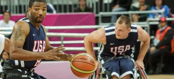 Two professional male basketball players in their wheelchairs during a game.