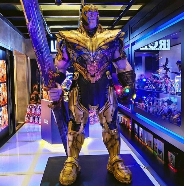 A life-size figure of Thanos wearing his gauntlet and armor.