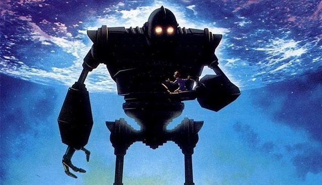 A scene from the movie The Iron Giant, with the gigantic metallic robot holding the young boy named Hogarth Hughes.