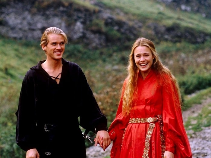 Westley and Buttercup in The Princess Bride, with Buttercup in her tunic-style red medieval dress and gold belt.
