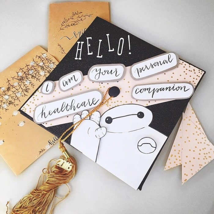 """A Baymax-inspired nursing graduation cap with the famous line, """"I am your personal healthcare companion."""""""