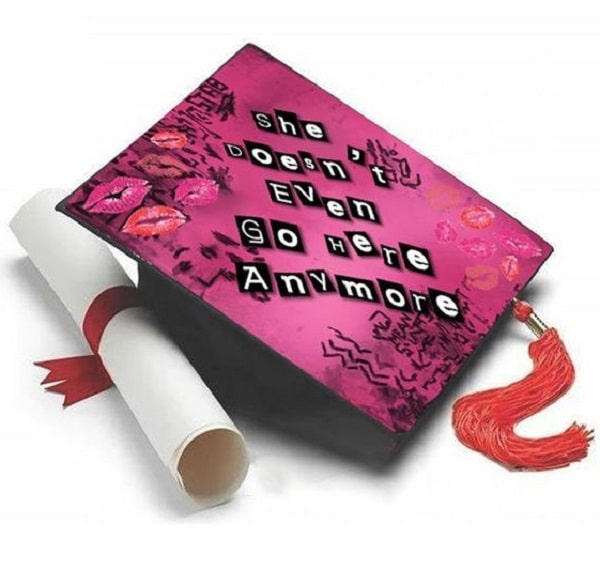 """A graduation cap inspired by the burn book from the movie Mean Girls with the words, """"She doesn't even go here anymore."""""""