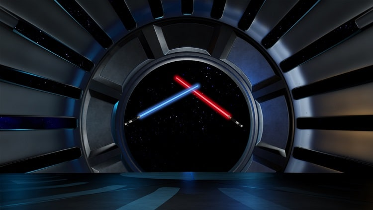 A red and blue lightsaber inside a spacecraft from Star Wars.