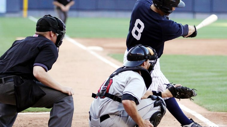 Baseball players in position during a college baseball game.