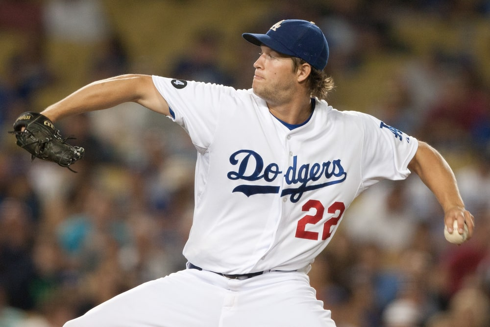 A Dodgers baseball player about to pitch a ball during a Major League Baseball game.