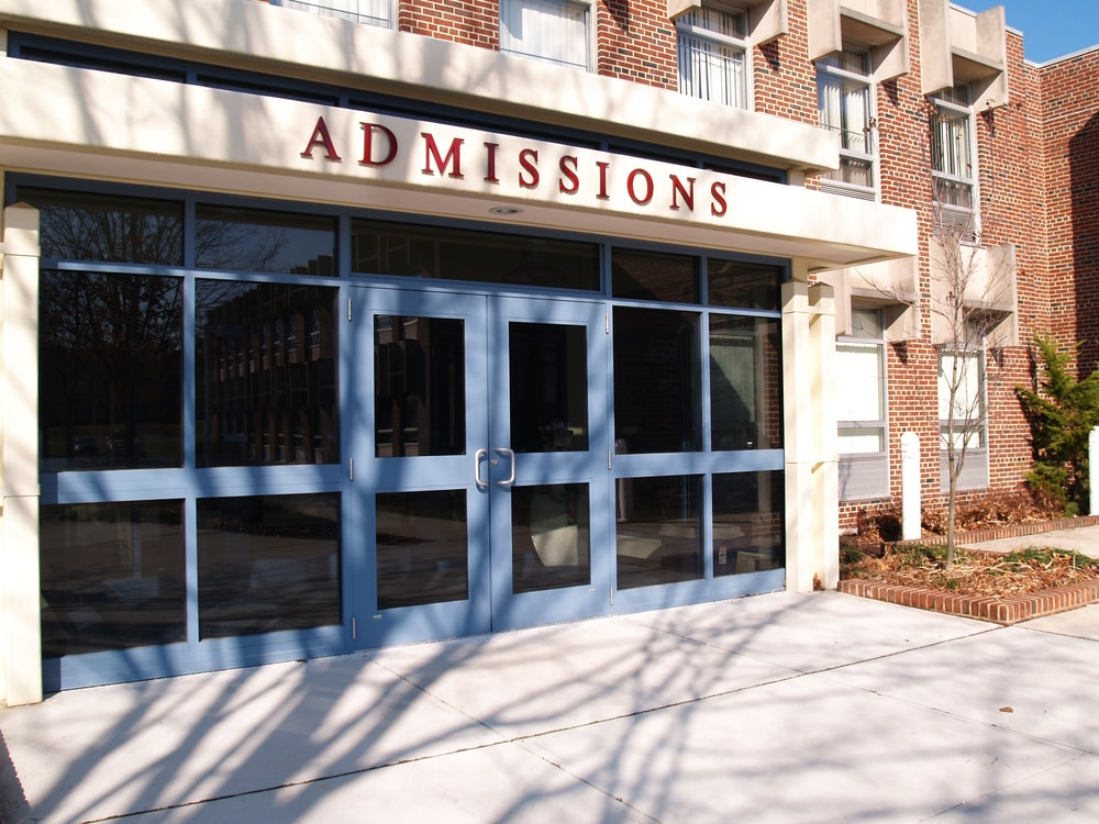 The facade of a college admissions building at daytime.
