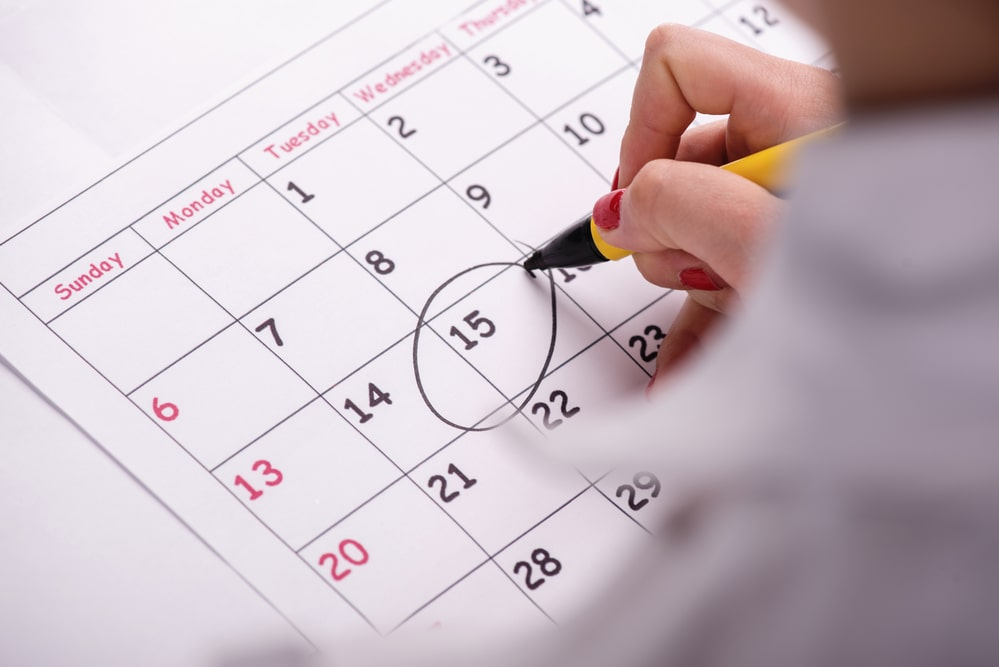 A school calendar with the date the semester starts encircled with black ink.