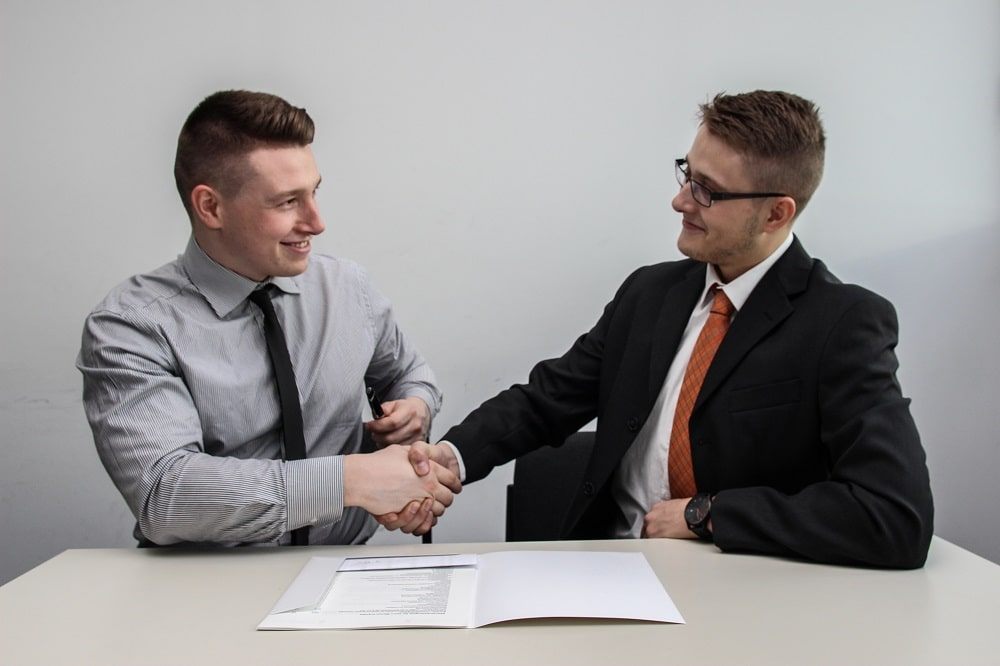 A man in a successful job interview ending in good results.
