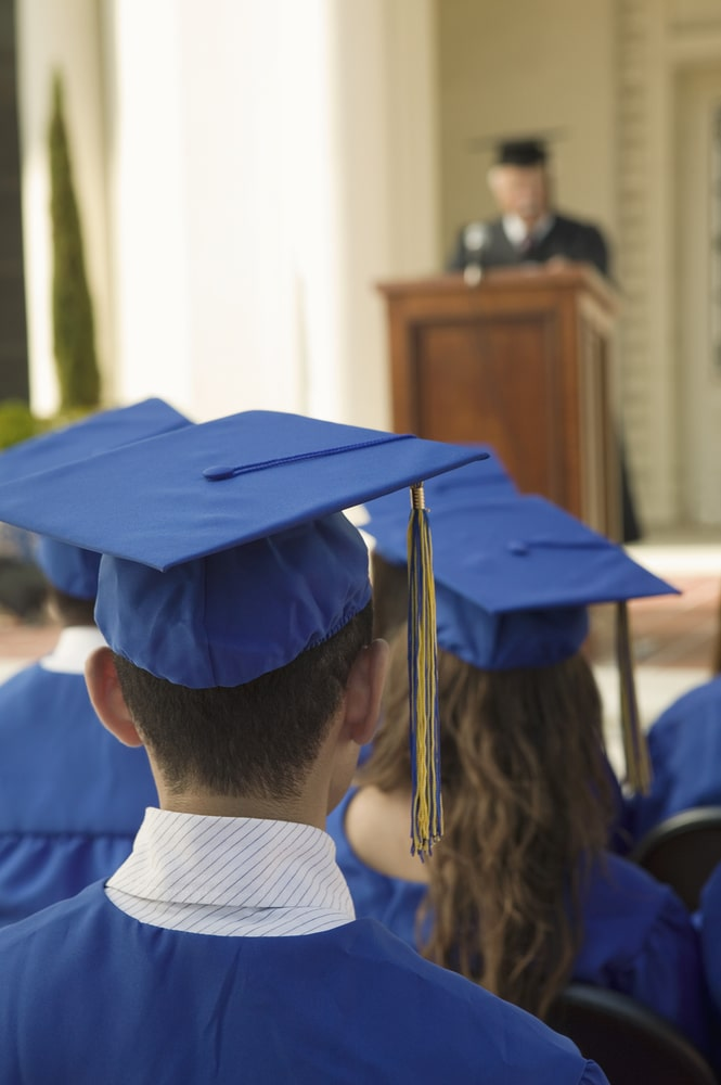 Graduates listening attentively to a well-written and exceptionally delivered commencement speech.