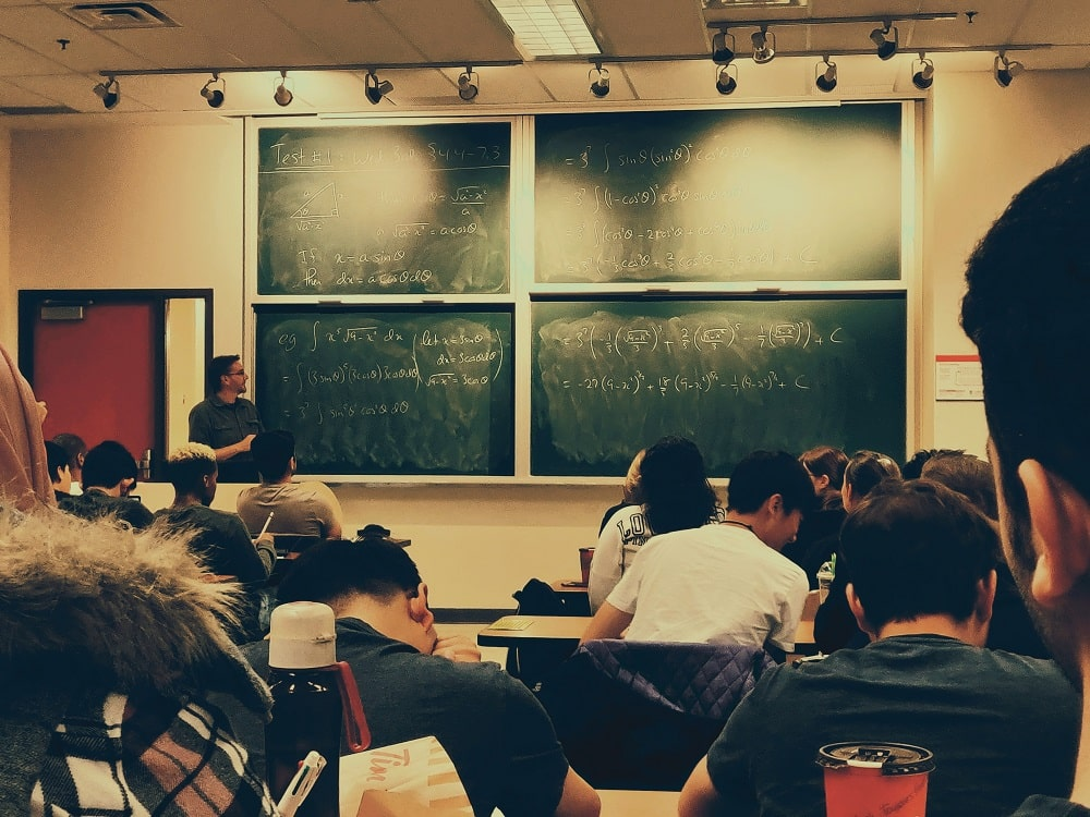 This is a look at a college math class with multiple boards.
