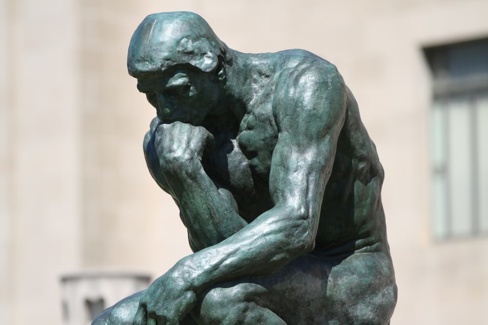 A close-up shot of the famous sculpture called The Thinker by August Rodin.